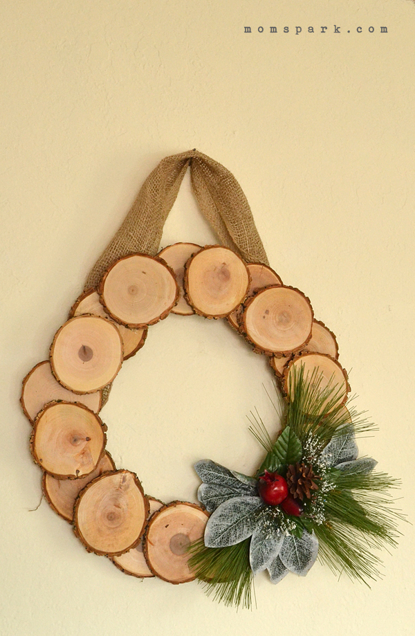Rustic Wood Slice Winter Wreath Tutorial There is something great about natural or rustic decor. It's like it never really goes out of style. I've had my fair share of faddish decorations and they normally find their way to the Goodwill after just a season or two. So with wood slices showing up in crafts everywhere and being much easier to find to purchase than even this time last year, I thought it would be awesome to make a wreath with them. I think that it looks smashing and it only took about 20 minutes to make. That's 20 minutes total, people. How great is that?