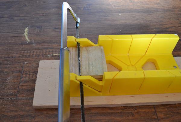 Repurpose wood scraps by turning them into simple and modern photo stands.