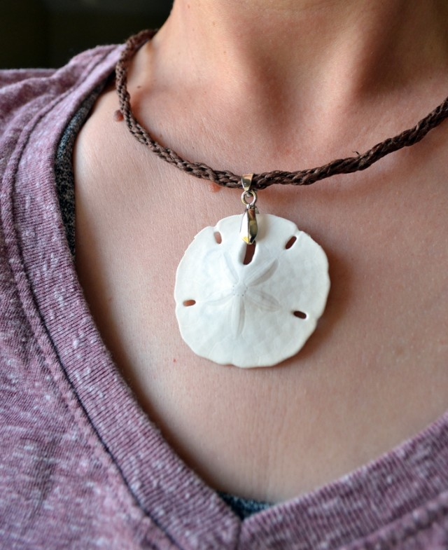 Turn a little beach vacation keepsake into a lovely pendant. DIY a kumihimo cord, too!