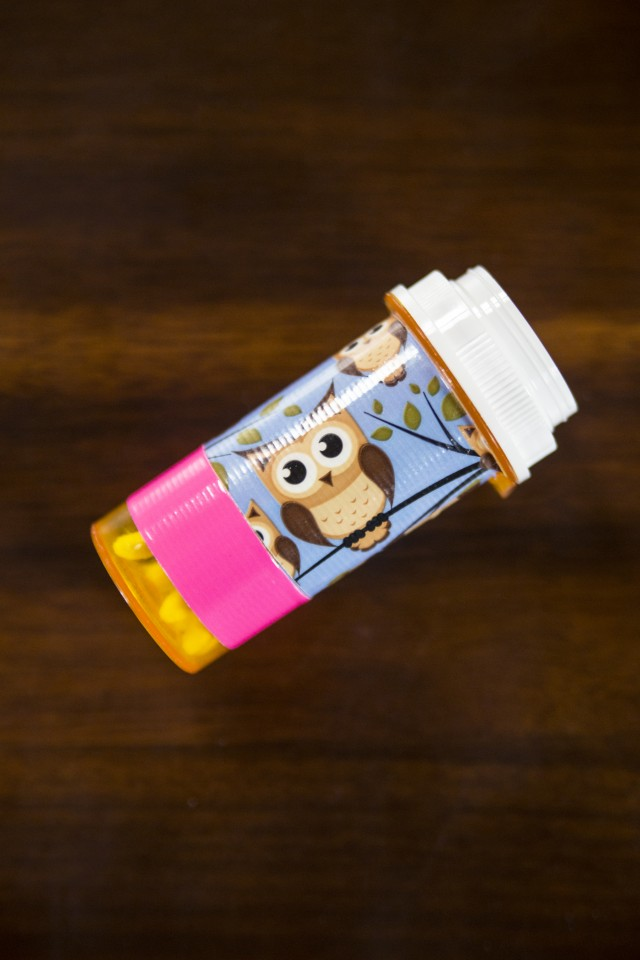 Prescription bottles for storage. Old prescription bottles dolled up with fun washi tape make great little storage tubes for cotton swabs, bobby pins, tweezers and more.