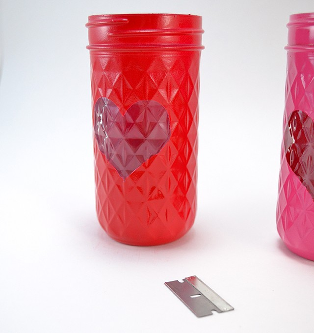 These mason jar luminaries are perfect for Valentine's Day!