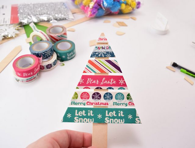These popsicle stick Christmas trees are easy enough to make you can get the kids involved! Fun for the whole family!