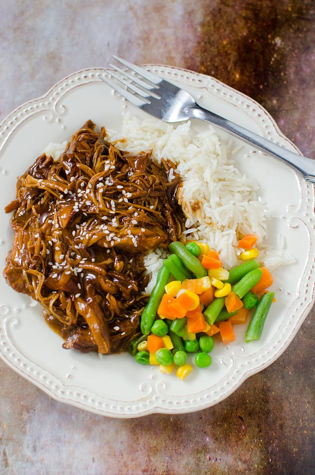 Slow Cooker Asian Honey Garlic Chicken Recipe! Is there anything better than the smell of dinner cooking low and slow in the Crock-pot? I say nope. Like this recipe for Asian Honey Garlic Chicken made in the slow cooker. Chicken breast that is slow cooked in a sweet and tangy sauce and then served over rice or noodles. Perfection!