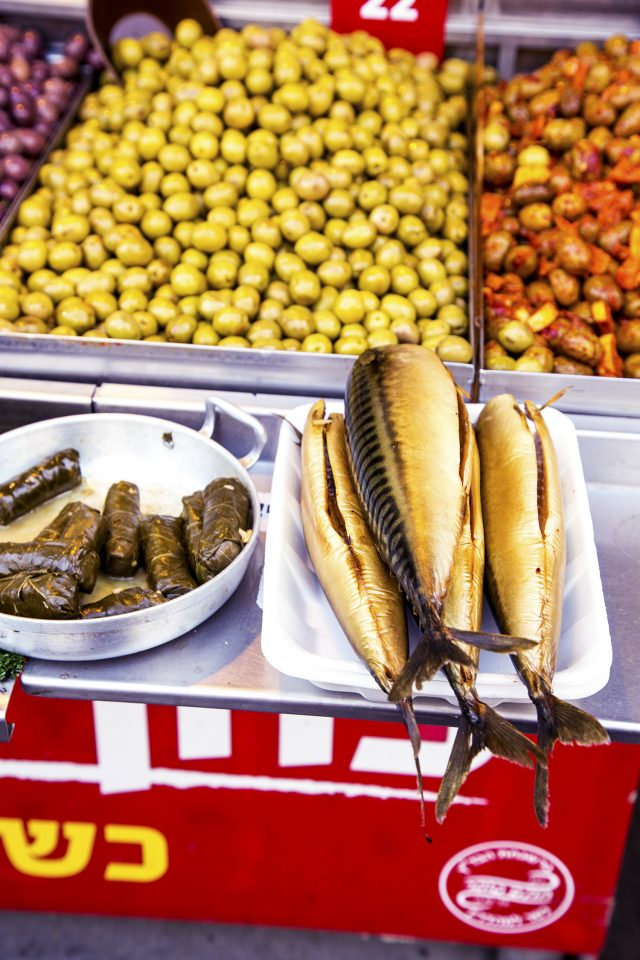 Fish, grape leaves and olives in the markets of Tel Aviv, Israel