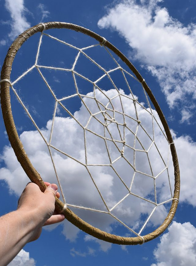 Make a GIANT dreamcatcher out of a hula hoop. How fun is this? Perfect for a statement wall!