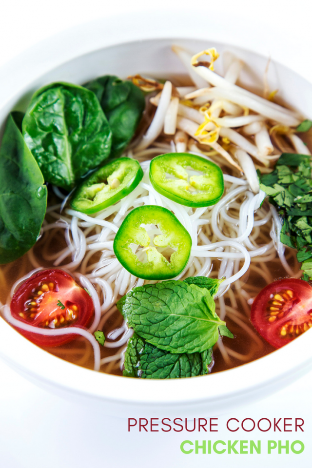 A rich broth full of tender chicken, scallions, Asian-inspired spices, and topped with bean sprouts, spinach, mint, cilantro, tomatoes, and spicy jalapeno, this pho made in a pressure cooker will rock your world.