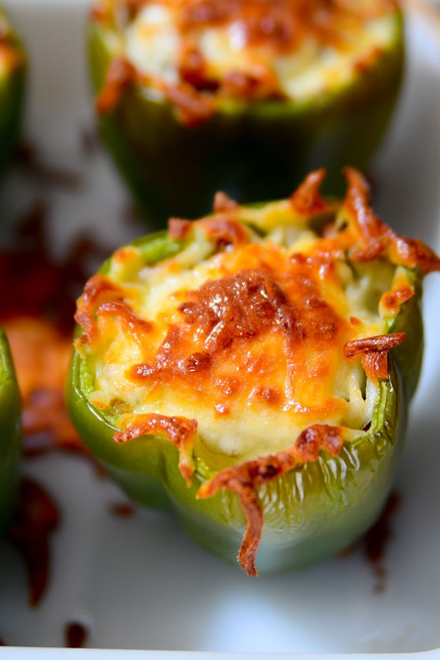 Italian sausage, quinoa, sauteed onions, and parmesan cheese stuffed inside of a fresh green bell pepper and topped with mozzarella cheese. A simple dinner recipe that your entire family will enjoy!